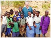 Peter with primary school children